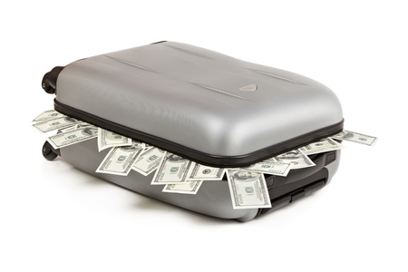 lot of money in a closed suitcase isolated on white photo