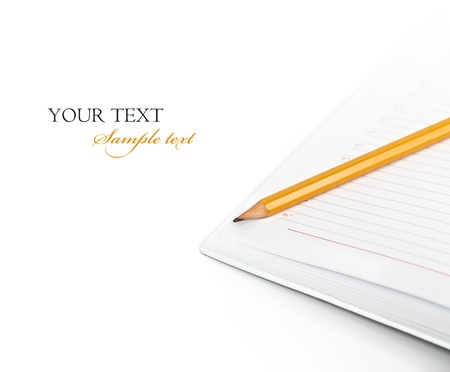 Pencil in a diary on a white background photo