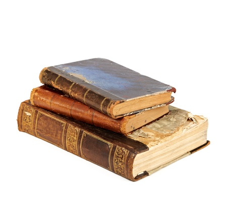 stack of old books on white background photo