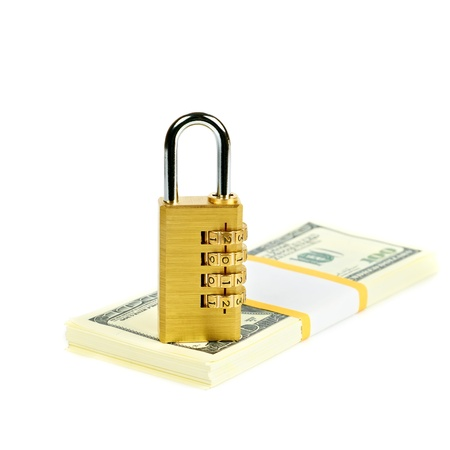 combination padlock on a stack of dollars Stock Photo - 14523771