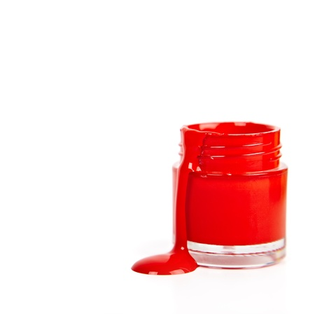 red  paint in glass container on a white background photo