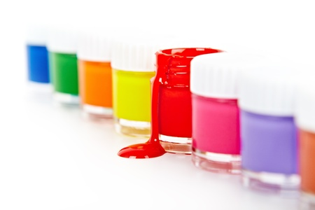 bright paints in glass containers on a white background photo