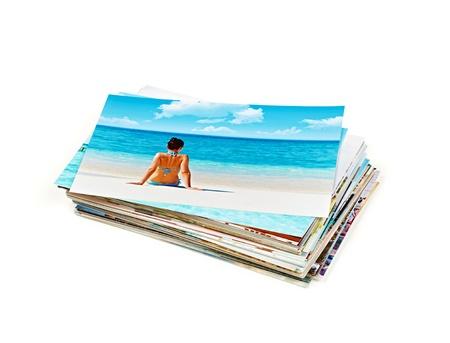 pile papier: Empiler des photos, isol� sur un fond blanc