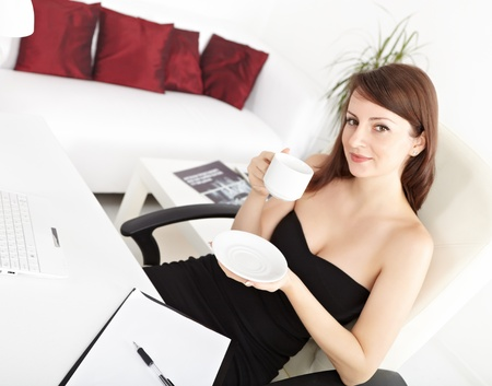 Portrait of a smart young businesswoman drinking coffee at office Stock Photo - 14510019