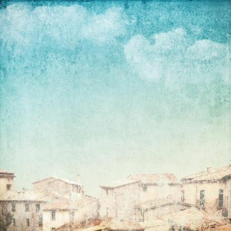 vintage postcard: vintage background with clouds and roofs