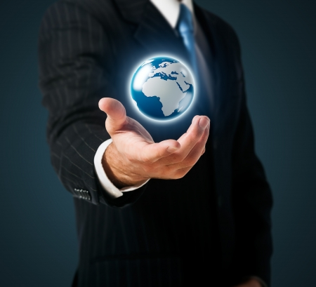 globe in hand: Businessman holds Earth in a hand