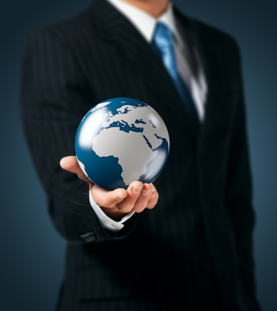 Businessman holds Earth in a hand Stock Photo - 15154570