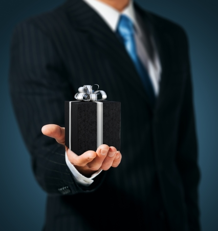 Man holding a gift box Stock Photo - 15154572