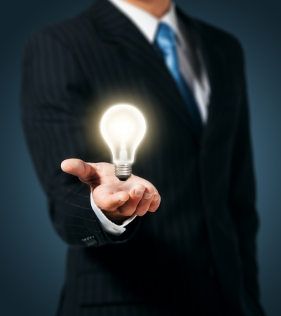 Light bulb in hand businessman  Imagens