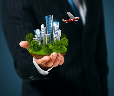 plane tree: Man holding a city  in hand Stock Photo