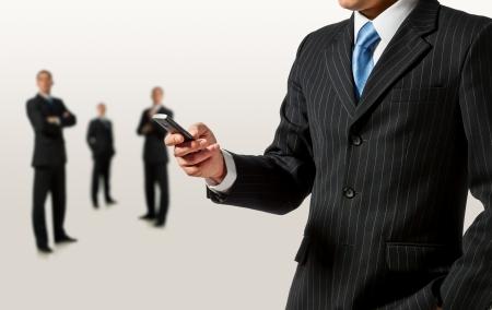 Businessman holding mobile phone Stock Photo - 15154577