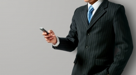 mobile office: Businessman holding mobile phone Stock Photo