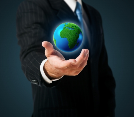 Businessman holds green Earth in a hand Stock Photo - 15171100