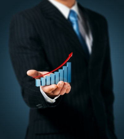 business growth: Man holds the chart of growth