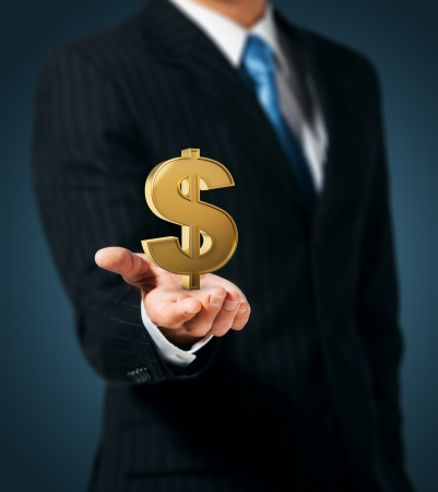 american  dollar: Businessman holding dollar sign