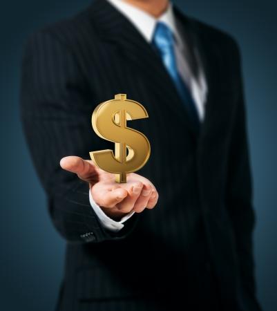 dollaro: Uomo d'affari che tiene il segno del dollaro