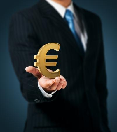 Businessman holding euro sign Stock Photo - 15171112