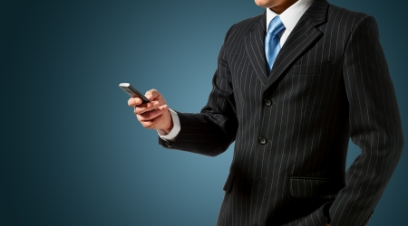 holding cell: Businessman holding mobile phone Stock Photo
