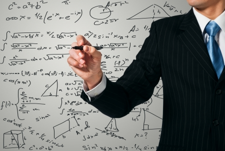 Man writing on the screen. Mathematics Stock Photo - 15171096