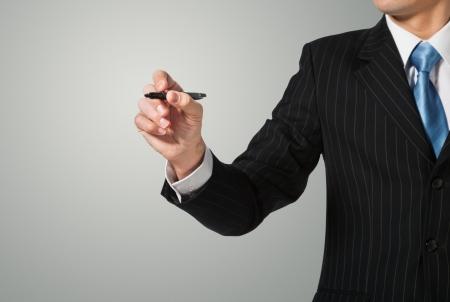planche: Businessman writing, dessiner sur l'�cran Banque d'images