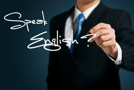 英語を学ぶ。男を話す画面に書き込みます 写真素材