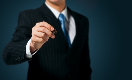 marcador: Escritura hombre de negocios, dibujar en la pantalla Foto de archivo