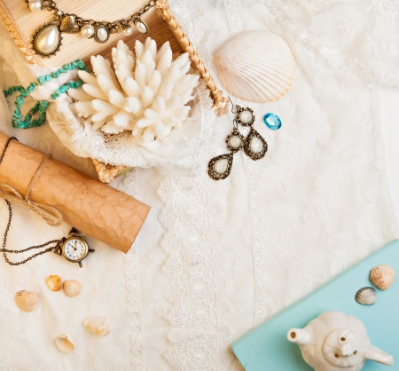 jewellery box: Vintage background with seashells, paper scroll, watch and jewelry. Romantic photo Stock Photo