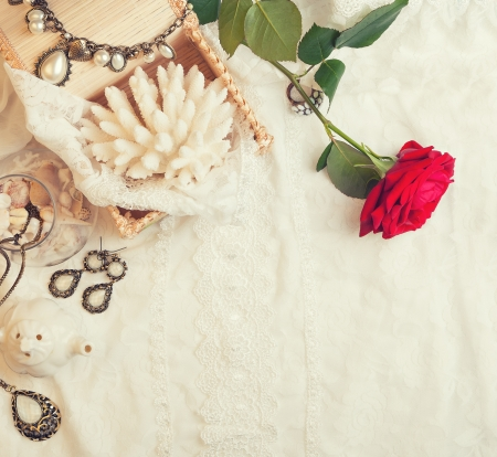 Vintage background with rose and jewelry photo