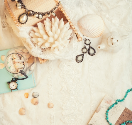Vintage background with seashells, watch and jewelry. Romantic photo photo