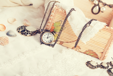 vanil: Vintage background with watch. Romantic photo Stock Photo