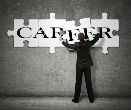 Businessman making a puzzle on the wall with the word Career Stock Photo - 16465284