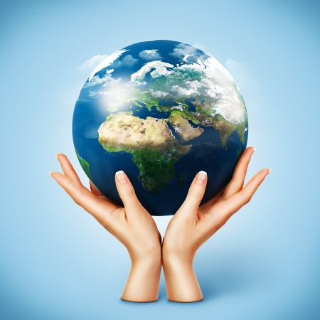 hands holding globe: Globe in womens hands. Planet