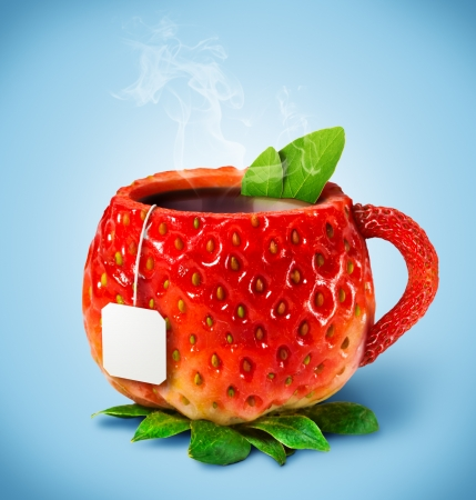 Cup from a strawberry with hot tea photo