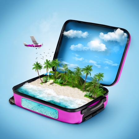 Open suitcase with a tropical island inside. Traveling photo