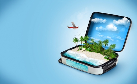Open suitcase with a tropical island inside  Traveling Stock Photo