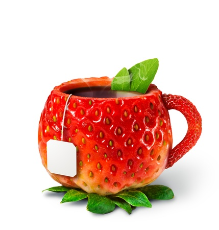 Cup from a strawberry with hot tea  healthy food photo