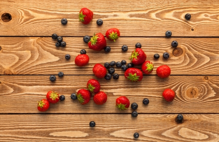Berries on Wooden Background. photo