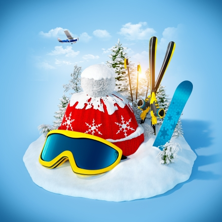 skiing equipment on the snowdrift at blue background  Winter holidays photo