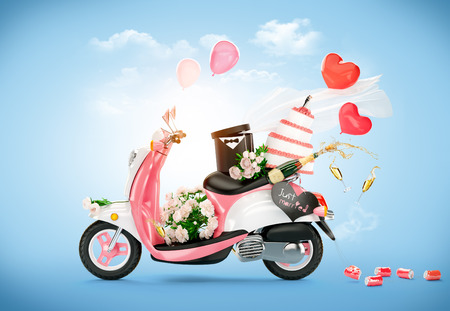 Vespa de la vendimia con flores, pastel de bodas y el champán. Boda. Luna de miel Foto de archivo
