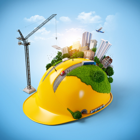constructor: Ciudad en el casco de la construcci�n. Foto de archivo