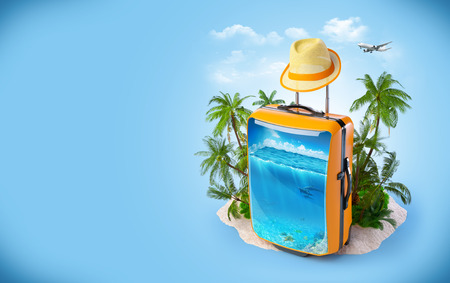 Luggage suitcase with ocean inside. Tropical background. Traveling