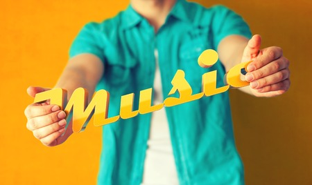 Man holds word Music on bright colorful background photo