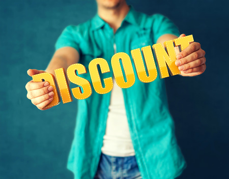 Man holds word Discount on bright colorful background photo