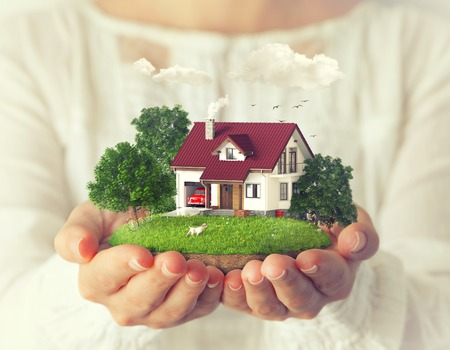 Small fantastic island with a house and backyard in womens hands. photo