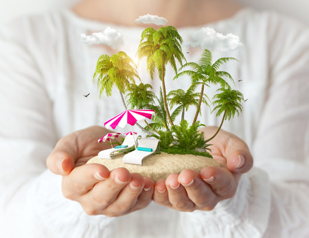 Small fantastic island with sunbeds and palms in women photo