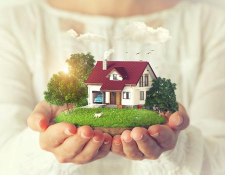 Kleine fantastisch eiland met een huis en achtertuin in de handen van vrouwen.