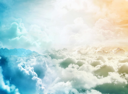 Over the Clouds. Fantastic background with clouds and mountain peaks