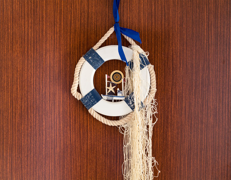 fisher: Lifebuoy on the door. welcome