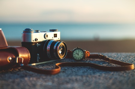 camera lens: Photo of vintage camera at sunset in park Stock Photo