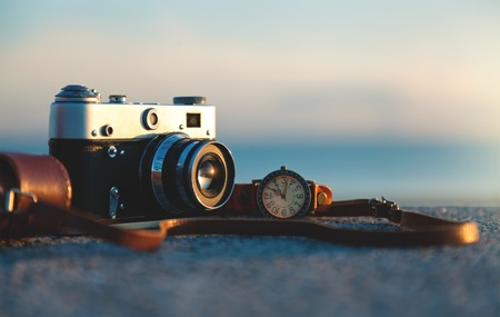 Photo of vintage camera at sunset in park Stock Photo